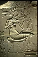 Akenaten, with his daughter. The sun-god Aten is at the upper-right